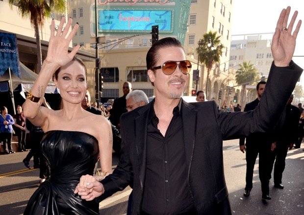 """File - 20. September 2016: Angelina Jolie's lawyer confirmed that the actress filed for divorce from her husband actor Brad Pitt. The couple has six children and Jolie is asking for physical custody. HOLLYWOOD, CA - MAY 28: Actors Angelina Jolie (L) and Brad Pitt attend the World Premiere of Disney's """"Maleficent"""" at the El Capitan Theatre on May 28, 2014 in Hollywood, California. (Photo by Kevin Winter/Getty Images)"""