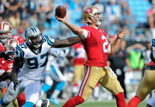 San Francisco 49ers' Blaine Gabbert (2) looks to pass under pressure from Carolina Panthers' Mario Addison (97) in the second half of an NFL football game in Charlotte, N.C., Sunday, Sept. 18, 2016. The Panthers won 46-27. (AP Photo/Mike McCarn)