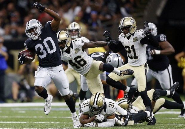 NEW ORLEANS, LA - SEPTEMBER 11: Jalen Richard #30 of the Oakland Raiders rushes for 75-yard touchdown during the second half of a game against the New Orleans Saints at Mercedes-Benz Superdome on September 11, 2016 in New Orleans, Louisiana. (Photo by Jonathan Bachman/Getty Images)