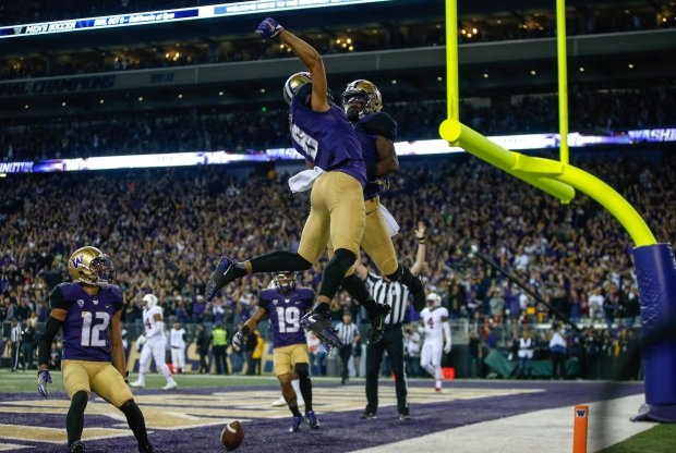 SEATTLE, WA - SEPTEMBER 30: Wide receiver John Ross #1 of the Washington Huskies is congratulated by wide receiver Dante Pettis #8 after scoring a touchdown against the Stanford Cardinal in the second quarter on September 30, 2016 at Husky Stadium in Seattle, Washington. (Photo by Otto Greule Jr/Getty Images)