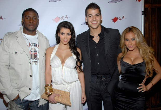 From left to right, footbal player Reggie Bush, television personality Kim Kardashian, television personality Rob Kardashian, and singer Adrienne Bailon pose on the press line at a pre-BET Awards party honoring rapper Lil Wayne and singer Usher in Los Angeles on Monday, June 23, 2008. (AP Photo/Dan Steinberg)