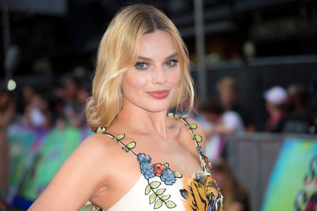 """FILE - In this Aug. 3, 2016 file photo, actress Margot Robbie poses for photographers upon arrival at the European Premiere of """"Suicide Squad,"""" in London. Robbie will host the season premiere of """"Saturday Night Live"""" and The Weeknd will be musical guest on October 1. (AP Photo/Joel Ryan, File)"""