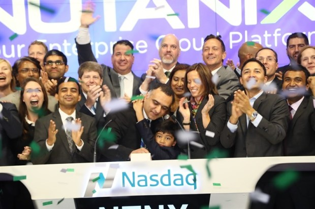 The Nutanix team celebrates the cloud computing startup's IPO Friday morning, September 30, 2016, during the opening bell ringing ceremony at the Nasdaq building in New York City's Times Square. (Courtesy of Nutanix)