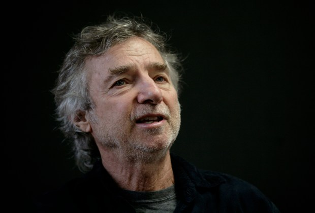 """FILE - In this Dec. 1, 2009 file photo, U.S. filmmaker Curtis Hanson, speaks during an interview at the International Book Fair in Guadalajara, Mexico. Hanson, who won an Oscar for the screenplay for """"L.A. Confidential"""" and directed Eminem in the movie """"8 Mile,"""" has died. Los Angeles police say paramedics called to Hanson's Hollywood Hills home found him dead Tuesday, Sept. 20, 2016. He was 71. (AP Photo/Carlos Jasso, File)"""