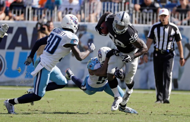 Oakland Raiders running back Latavius Murray (28) is stopped by Tennessee Titans defenders Jason McCourty (30) and Avery Williamson (54) in the second half of an NFL football game Sunday, Sept. 25, 2016, in Nashville, Tenn. (AP Photo/James Kenney)