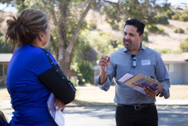 San Jose City Council candidate, Sergio Jimenez, talks with Maggie Duarte as he canvases a neighborhood in San Jose, Calif., Friday, Sept. 16, 2016. Jimenez is running against Steve Brown for the San Jose District 2 City Council seat in November. (Patrick Tehan/Bay Area News Group)