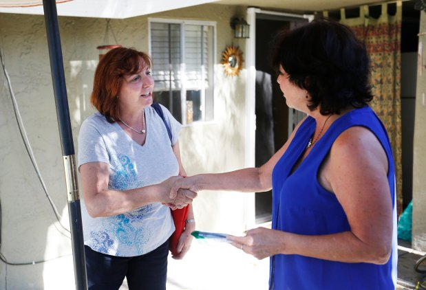 City council candidate, Helen Chapman, left, talks with resident, Debra Benavides, while canvassing a neighborhood in San Jose, Calif., Wednesday, Sept. 21, 2016. (Patrick Tehan/Bay Area News Group)