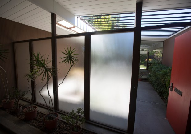 The entrance to the atrium of the Eichler home of Vilma and Don Buck photographed in Sunnyvale, Calif., Tuesday, Aug. 30, 2016. The couple has lived in their Eichler for 50 years. Built as high-quality affordable homes in the middle of the last century, modest, airy, glass-lined Eichler homes are now highly sought-after -- and valuable. (Patrick Tehan/Bay Area News Group)