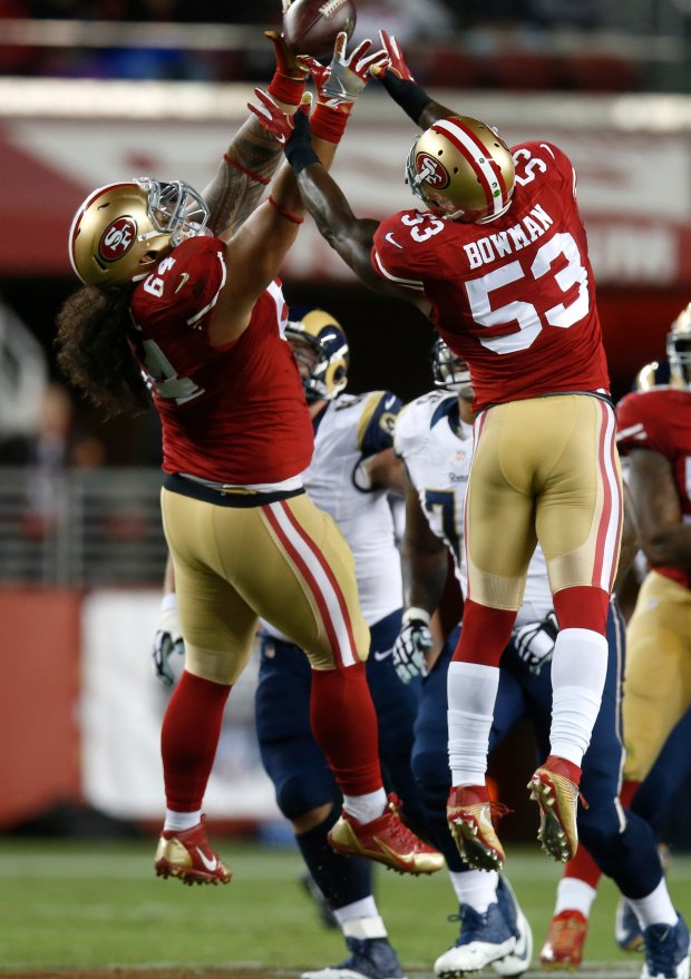 San Francisco 49ers' NaVorro Bowman (53) comes down with an interception on a tipped ball against the Los Angeles Rams in the second quarter of their NFL game at Levi's Stadium in Santa Clara, Calif., on Monday, Sept. 12, 2016. (Nhat V. Meyer/Bay Area News Group)