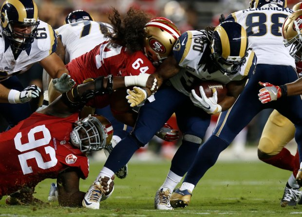 Los Angeles Rams' Todd Gurley (30) is tackled against the San Francisco 49ers defense in the first quarter of their NFL game at Levi's Stadium in Santa Clara, Calif., on Monday, Sept. 12, 2016. (Nhat V. Meyer/Bay Area News Group)