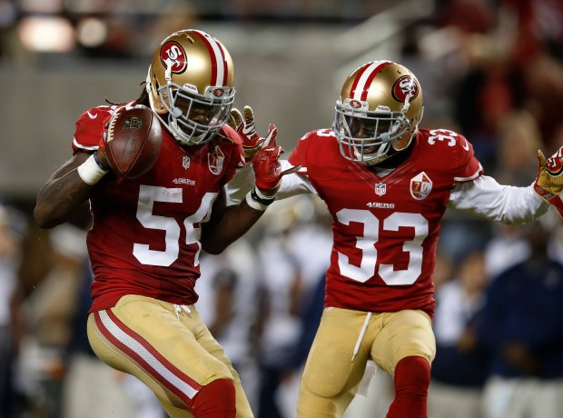 San Francisco 49ers' Ray-Ray Armstrong (54) dances after incepting the ball with San Francisco 49ers' Rashard Robinson (33) during their game against the Los Angeles Rams in the third quarter of their NFL game at Levi's Stadium in Santa Clara, Calif., on Monday, Sept. 12, 2016. (Nhat V. Meyer/Bay Area News Group)