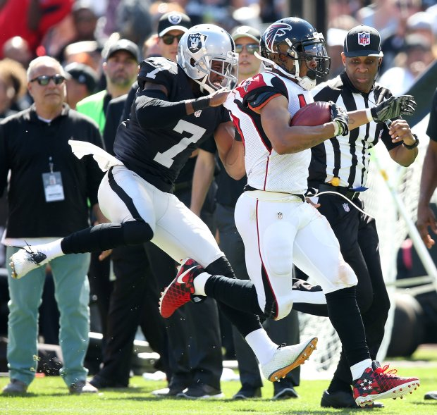 The Oakland Raider's Marquette King tackles the Atlanta Falcon's Eric Weems during the second quarter of their game on Sunday, Sept. 18, 2016, in Oakland, Calif. (Aric Crabb/Bay Area News Group)