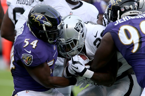 Zachary Orr #54 and Timmy Jernigan #99 of the Baltimore Ravens tackle Latavius Murray #28 of the Oakland Raiders in the first quarter at M&T Bank Stadium on October 2, 2016 in Baltimore, Maryland. (Photo by Dylan Buell/Getty Images)