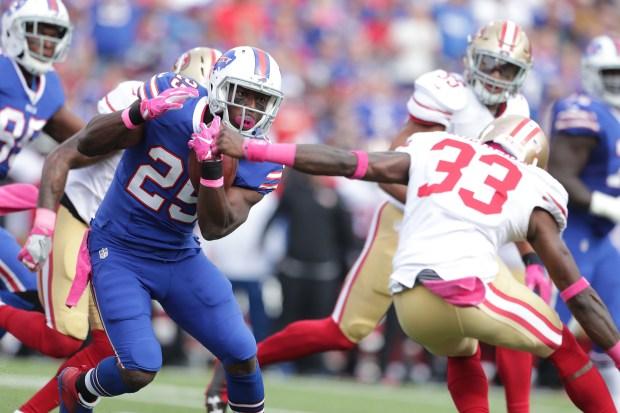 LeSean McCoy #25 of the Buffalo Bills breaks a tackle by Rashard Robinson #33 of the San Francisco 49ers during the first half at New Era Field on October 16, 2016 in Buffalo, New York. (Photo by Brett Carlsen/Getty Images)