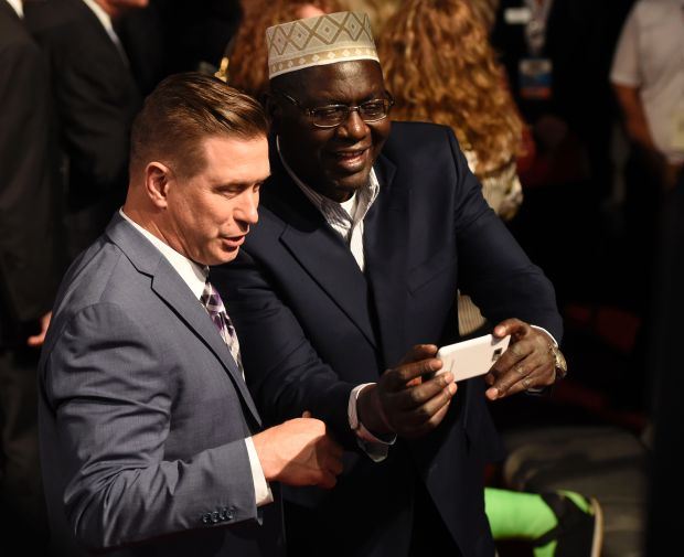 Malik Obama (R), President Barack Obama's Kenyan-born half-brother, meets with actor Stephen Baldwin after the final presidential debate at the Thomas & Mack Center on the campus of the University of Las Vegas in Las Vegas, Nevada on October 19, 2016. / AFP PHOTO / SAUL LOEBSAUL LOEB/AFP/Getty Images