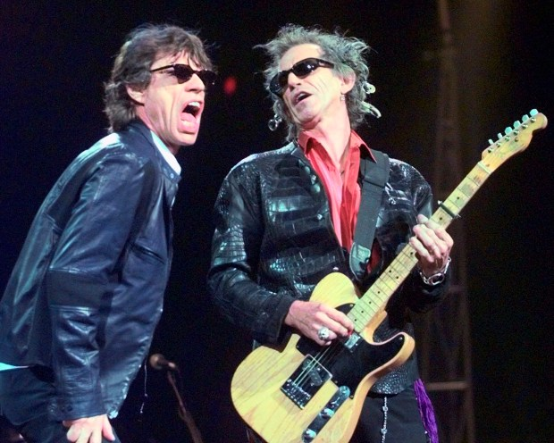 "FILE - In this Monday, March 22, 1999, file photo, Mick Jagger, left, and Keith Richards perform ""Jumping Jack Flash"" during the Rolling Stones' No Security Tour performance at the Fleet Center in Boston. It's back to the blues for the Rolling Stones. The band that first made its name covering songs by American blues artists Thursday Oct. 6, 2016 announced plans to release a blues album in December. The ""Blue & Lonesome"" album will be their first studio release in more than a decade. (AP Photo/Elise Amendola, File)"