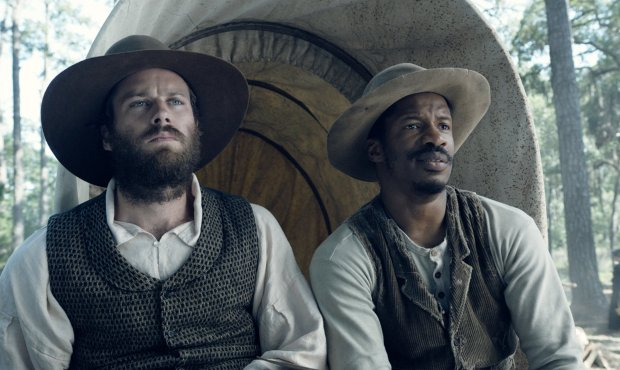 "In this image released by Fox Searchlight Pictures, Armie Hammer portrays Samuel Turner, left, and Nate Parker portrays Nat Turner in a scene from ""The Birth of a Nation."" (Fox Searchlight Pictures via AP)"