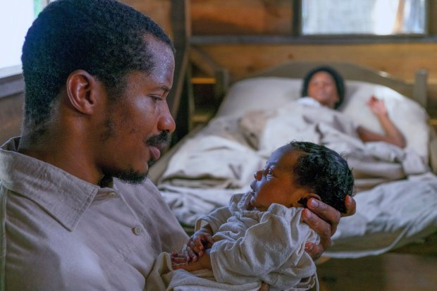 "This image released by Fox Searchlight Films shows Nate Parker as Nat Turner in a scene from ""The Birth of a Nation."" (Jahi Chikwendiu/Fox Searchlight via AP)"