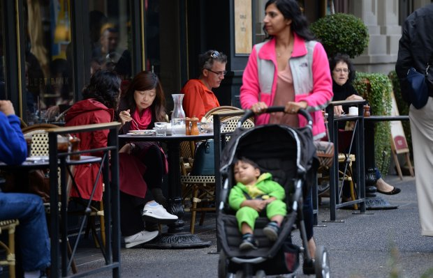 "Patrons enjoy their lunch in the sidewalk seating area of the Left Bank restaurant at Santana Row in San Jose, Calif., on Tuesday, Oct. 25, 2016. This new architectural trend know as ""city centers"" or ""lifestyle centers"" has caught on all over the Bay Area, mixing residential, retail, restaurants, hotels and the like all around town squares. (Dan Honda/Bay Area News Group)"