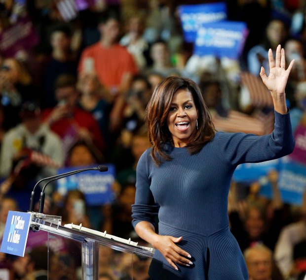 First lady Michelle Obama arrives to a cheering crowd during a campaign rally for Democratic presidential candidate Hillary Clinton Thursday, Oct. 13, 2016, in Manchester, N.H. (AP Photo/Jim Cole)