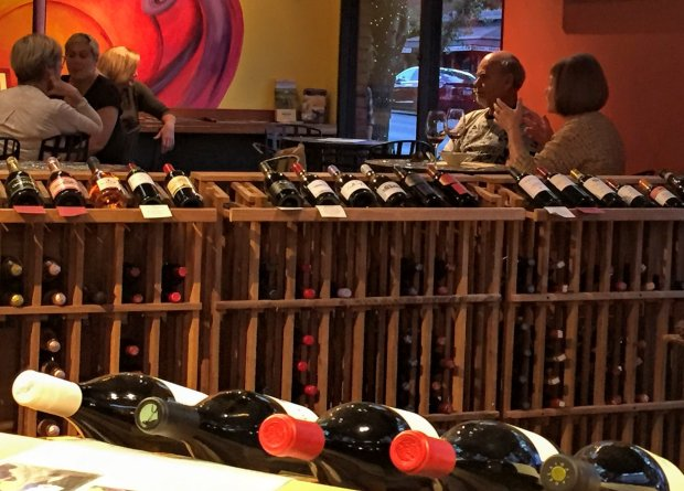 Sipping among the wine bottles at Saratoga's Uncorked! wine shop and tasting bar. Photo credit: Mary Orlin/Staff