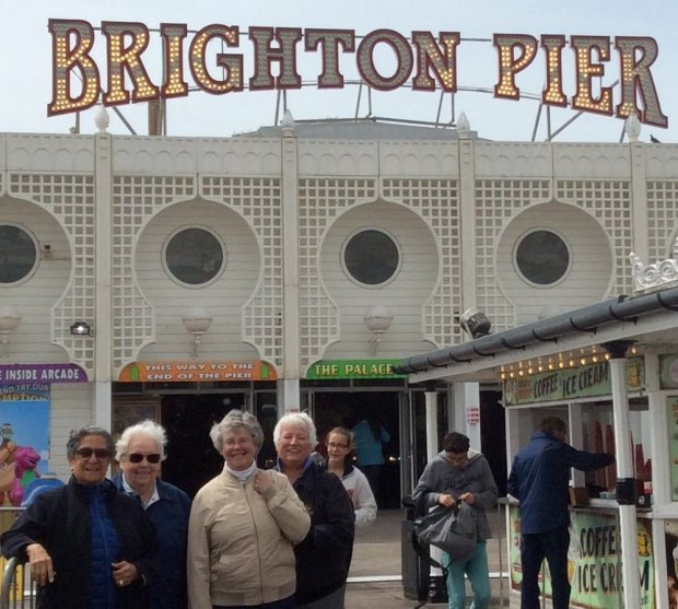 ENGLAND: Cupertino residents Micki Morales and Becky Bartunek, and Palo Alto residents Wendy Smith and Meredith Ross took a turn around the Brighton Pier while visiting England last spring. (Courtesy of Micki Morales)