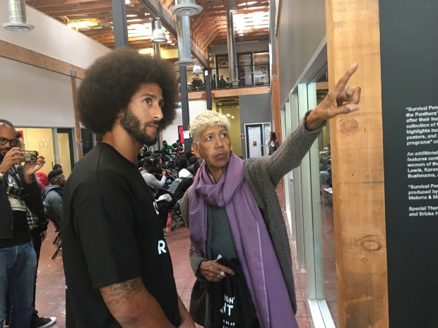 Colin Kaepernick talks with Ericka Huggins, a former leading member of the Black Panther Party, at his Know Your Rights camp at Impact Hub in Oakland on October 29, 2016 (Marcus Thompson/ Bay Area News Group)