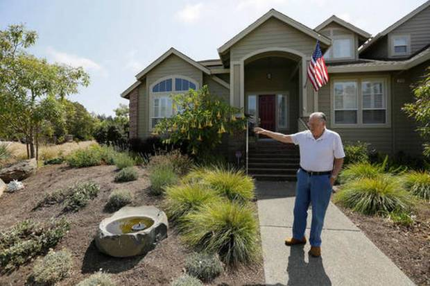 In this photo taken Tuesday, Aug. 23, 2016, Bill Crowell shows his garden made to use less amount of water at his home in the Fountaingrove neighborhood in Santa Rosa, Calif. California water agencies that spent more than $350 million in the last two years of drought to pay property owners to rip out water-slurping lawns are now trying to answer whether the nation's biggest lawn removal experiment was all worth the cost. (Eric Risberg AP Photo)