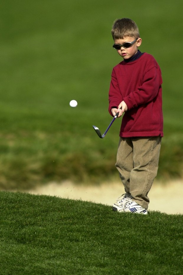 Maverick McNealy (cq, 5), the son of amateur Scott McNealy, chips on the 17th hole at the Pebble Beach Golf Course, in Pebble Beach, Calif., during his father's practice round for the upcoming AT&t Pebble Beach National Pro-Am on Tuesday, January 30, 2001. Maverkick hopes to someday be the playing partner of Tiger Woods. The weather was beautiful and the hope is for a dry week for the usually wet tournament. (Contra Costa Times/Dan Honda) 2001 slug: ATTTUES