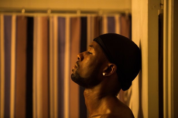"In this image released by A24 Films, Trevante Rhodes appears in a scene from, ""Moonlight."" (David Bornfriend/A24 via AP)"