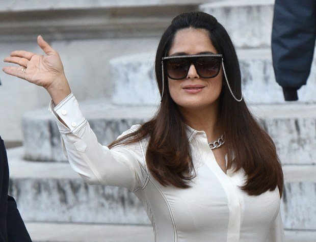 Mexican actress Salma Hayek waves after the presentation of Stella McCartney's Spring-Summer 2017 ready-to-wear fashion collection, Monday, Oct. 3, 2016 in Paris. (AP Photo/Zacharie Scheurer)