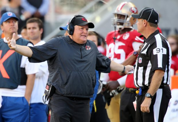 San Francisco 49ers head coach Chip Kelly has a conversation with head linesman Jeery Bergman (1) in the second half of an NFL game against the Dallas Cowboys at Levi's Stadium in Santa Clara, Calif., on Sunday, Oct. 2, 2016. (Josie Lepe/Bay Area News Group)