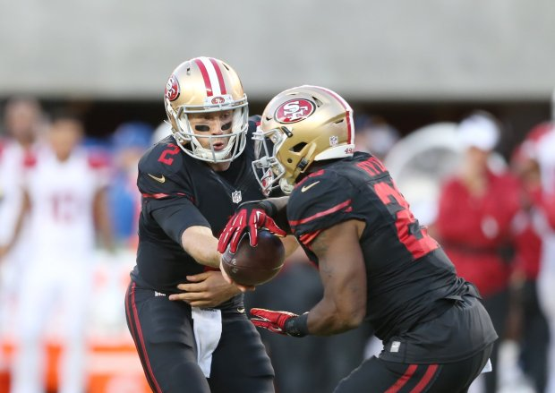San Francisco 49ers starting quarterback Blaine Gabbert (2) passes the ball to San Francisco 49ers' Carlos Hyde (28) against Arizona Cardinals in the first half in their NFL game at Levi's Stadium in Santa Clara, Calif., on Thursday, Oct. 6, 2016. (Josie Lepe/Bay Area News Group)