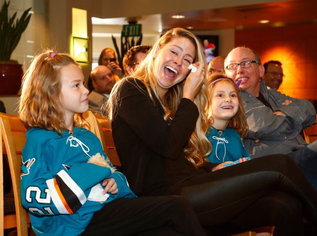 Amber Boyle laughs and sheds tears as her husband, Sharks Dan Boyle announces his retirement during a press conference held at the SAP Center in San Jose, Calif., on Wednesday, Oct. 5, 2016. Boyle was the highest-scoring defenseman in Sharks history. Boyle's children left to right are Eastin Boyle, 7, and Wesley Boyle, 6. (Gary Reyes/Bay Area News Group)