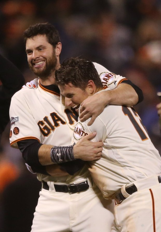 San Francisco Giants' Brandon Belt (9) celebrates with San Francisco Giants' Joe Panik (12) after winning 6-5 after hitting a double against Chicago Cubs in the thirteen inning of Game 3 of the National League Division Series at AT&T Park in San Francisco, Calif., on Monday, Oct. 10, 2016. (Josie Lepe/Bay Area News Group)