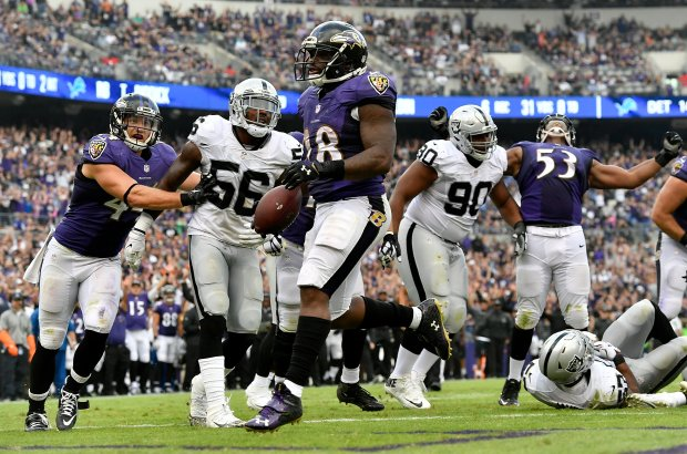 BALTIMORE, MD - OCTOBER 2: Terrance West #28 of the Baltimore Ravens scores a touchdown in the fourth quarter against the Oakland Raiders at M&T Bank Stadium on October 2, 2016 in Baltimore, Maryland. (Photo by Larry French/Getty Images)