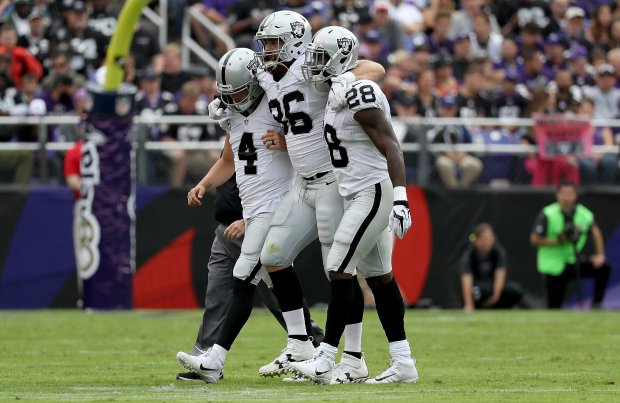 BALTIMORE, MD - OCTOBER 2:  Lee Smith #86 of the Oakland Raiders is helped off the field by Derek Carr #4 and Latavius Murray #28 after being injured in the second quarter against the Baltimore Ravens at M&T Bank Stadium on October 2, 2016 in Baltimore, Maryland.  (Photo by Rob Carr/Getty Images)