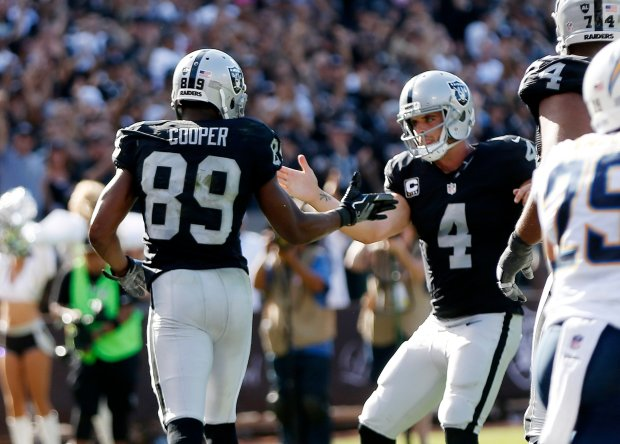 Oakland Raiders' Amari Cooper (89) celebrates a 2-point conversion with Derek Carr (4) against the San Diego Chargers in the second half of their NFL game at the Coliseum in Oakland, Calif., on Sunday, Oct. 9, 2016. (Josie Lepe/Bay Area News Group)