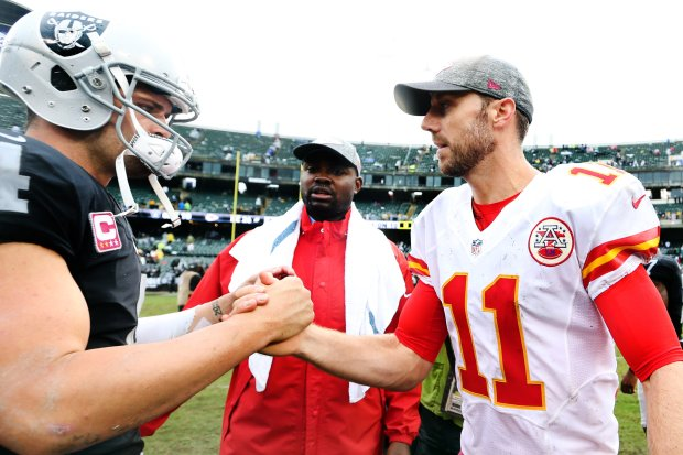 Oakland Raiders quarterback Derek Carr (4) and Kansas City Chiefs quarterback Alex Smith (11) shake hands after the Raiders lost 26-10 in their NFL game at Oakland Coliseum in Oakland, Calif, on Sunday, Oct. 16, 2016. (Ray Chavez/Bay Area News Group)