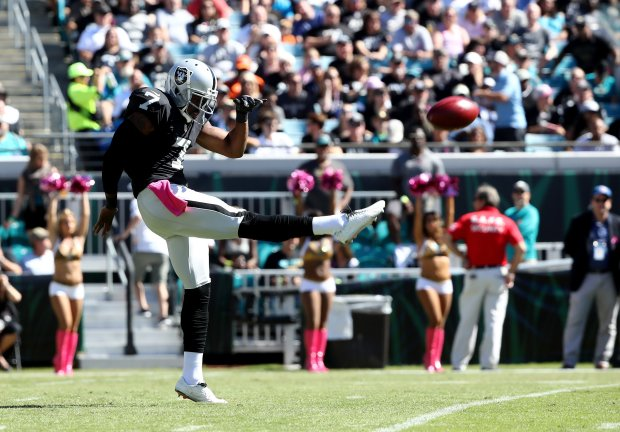 JACKSONVILLE, FL - OCTOBER 23:   Marquette King #7 of the Oakland Raiders punts against the Jacksonville Jaguars during the game at EverBank Field on October 23, 2016 in Jacksonville, Florida.  (Photo by Sam Greenwood/Getty Images)