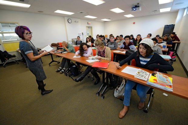 English teacher Michelle Gonzales, left, asks a question from student Virginia Gomes, 17, of Dublin, while enrolled in English 1A class at Las Positas College in Livermore, Calif., on Monday, Oct. 3, 2016. (Jose Carlos Fajardo/Bay Area News Group)