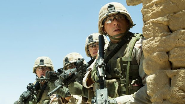 Members of the Bravo Platoon in Iraq include Billy Lynn (Joe Alwyn), third from left, and Sgt. Shroom (Vin Diesel), right. (Mary Cybulski/Sony-TriStar Pictures)