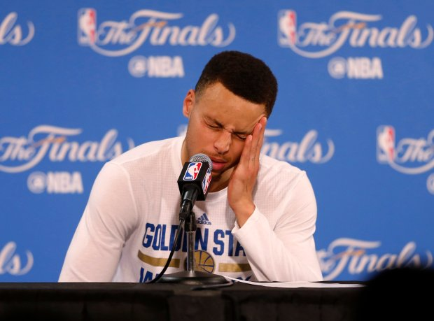 Golden State Warriors' Stephen Curry (30) answers questions during a press conference after the Cleveland Cavaliers beat the Warriors in Game 7 93-89 for the NBA Finals at Oracle Arena in Oakland, Calif., on Sunday, June 19, 2016. (Nhat V. Meyer/Bay Area News Group)