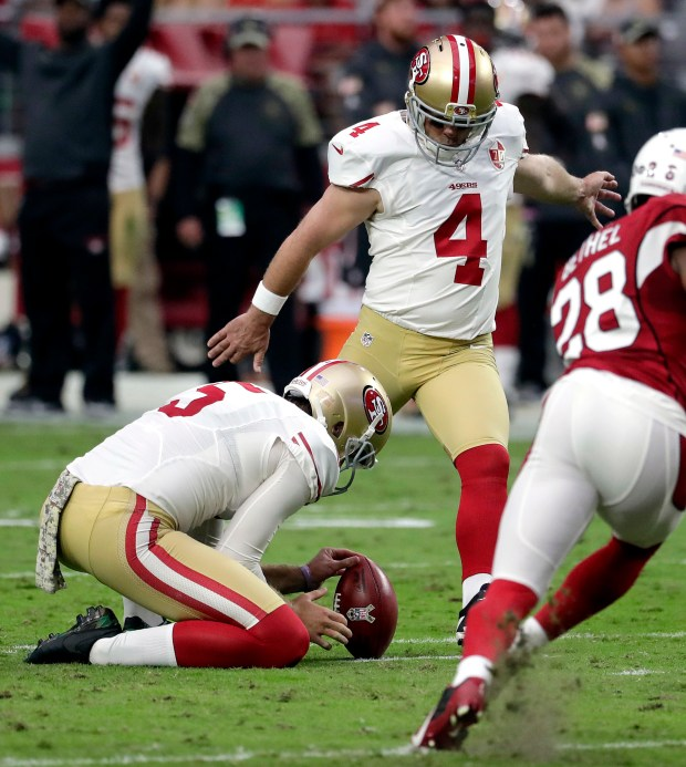 San Francisco 49ers kicker Phil Dawson (4) kicks a field goal as teammate Bradley Pinion (5) holds during the first half of an NFL football game against the Arizona Cardinals, Sunday, Nov. 13, 2016, in Glendale, Ariz. (AP Photo/Rick Scuteri)