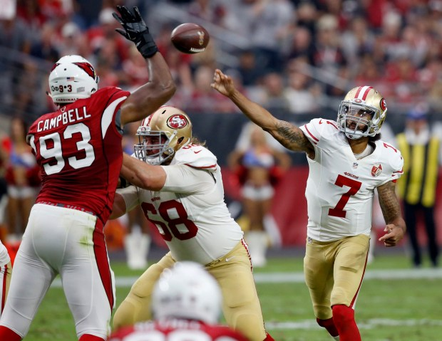 San Francisco 49ers quarterback Colin Kaepernick (7) throws over Arizona Cardinals defensive end Calais Campbell (93) during the first half of an NFL football game, Sunday, Nov. 13, 2016, in Glendale, Ariz. (AP Photo/Ross D. Franklin)