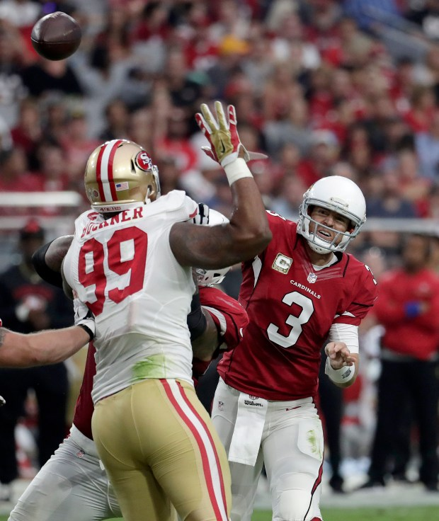 Arizona Cardinals quarterback Carson Palmer (3) throws over San Francisco 49ers defensive end DeForest Buckner (99) during the first half of an NFL football game, Sunday, Nov. 13, 2016, in Glendale, Ariz. (AP Photo/Rick Scuteri)