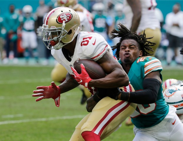 Miami Dolphins cornerback Bobby McCain (28) tackles San Francisco 49ers wide receiver Rod Streater (81), during the second half of an NFL football game, Sunday, Nov. 27, 2016, in Miami Gardens, Fla. (AP Photo/Lynne Sladky)