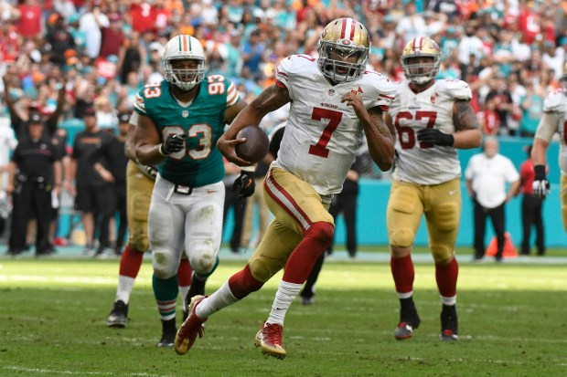 Colin Kaepernick #7 of the San Francisco 49ers rushes during the 4th quarter against the Miami Dolphins at Hard Rock Stadium on November 27, 2016 in Miami Gardens, Florida. (Photo by Eric Espada/Getty Images)