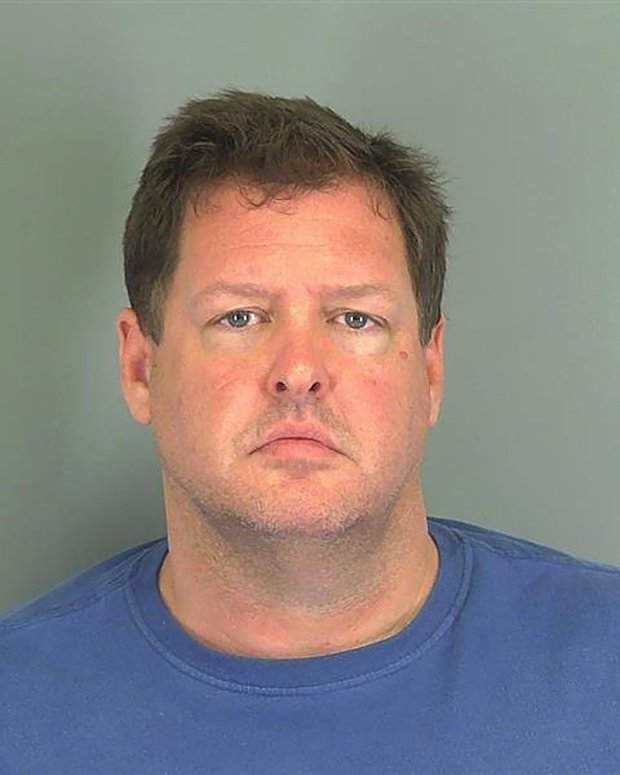 "(FILES) This file photo released on November 5, 201 shows a booking photo provided by the Spartanburg County Sheriff's Office in South Carolina of Todd Kohlhepp. Police in South Carolina found a body on November 5, 2016, buried on a property where a woman ""chained like a dog"" has been rescued. Spartanburg County Sheriff Chuck Wright said at a news conference ""we did find a body on a shallow grave on this piece of property at around 10 this morning."" The owner of the property in the town of Woodruff, northeast of the state capital Columbia, is Todd Kohlhepp, 45, a real-estate agent and registered sex offender. / AFP PHOTO / Spartanburg County Sheriff's Office / Handout / RESTRICTED TO EDITORIAL USE - MANDATORY CREDIT AFP PHOTO / Spartanburg County Sheriff's Office - NO MARKETING - NO ADVERTISING CAMPAIGNS - DISTRIBUTED AS A SERVICE TO CLIENTS HANDOUT/AFP/Getty Images"