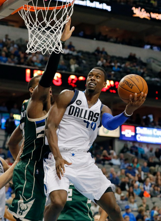Dallas Mavericks forward Harrison Barnes (40) goes up for a shot as Milwaukee Bucks' Greg Monroe, rear, defends in the second half of an NBA basketball game, Sunday, Nov. 6, 2016, in Dallas. Barnes scored 34 points in the 86-75 Mavericks overtime win. (AP Photo/Tony Gutierrez)